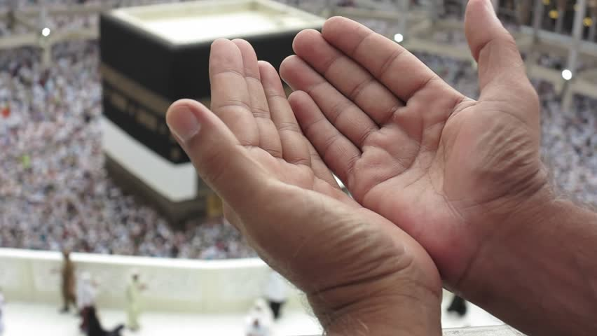 Kaaba Mecca Hajj Muslim people crowd praying and hands closeup  pov
