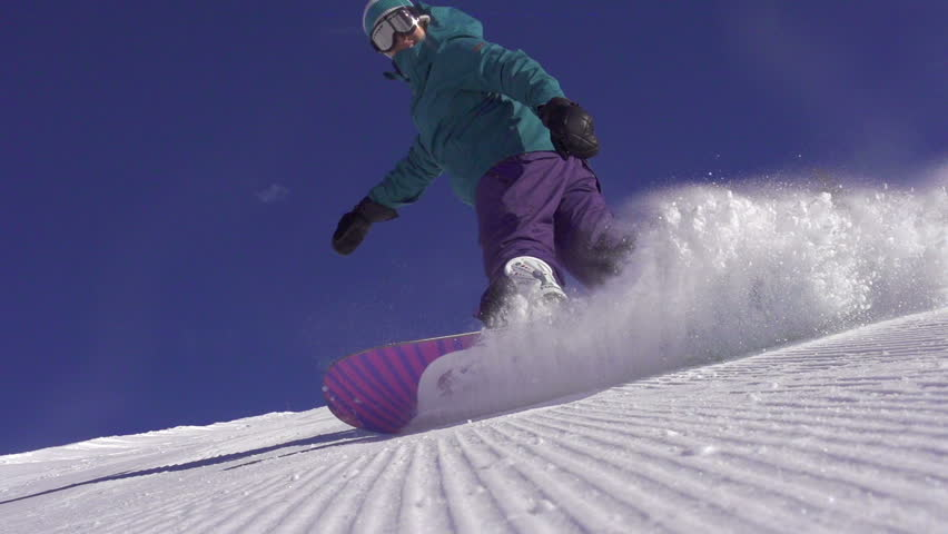 SLOW MOTION: Snowboarder girl sprays snow into the camera | Shutterstock HD Video #5405816