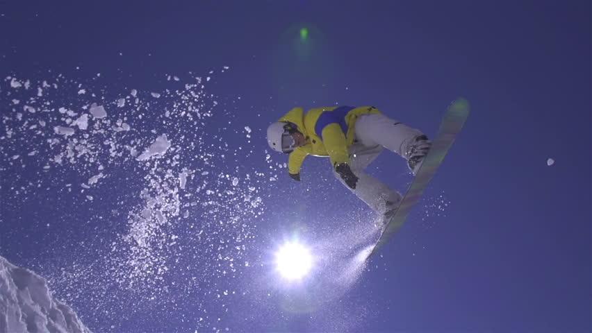SLOW MOTION: Snowboarder jumps the kicker | Shutterstock HD Video #5412383