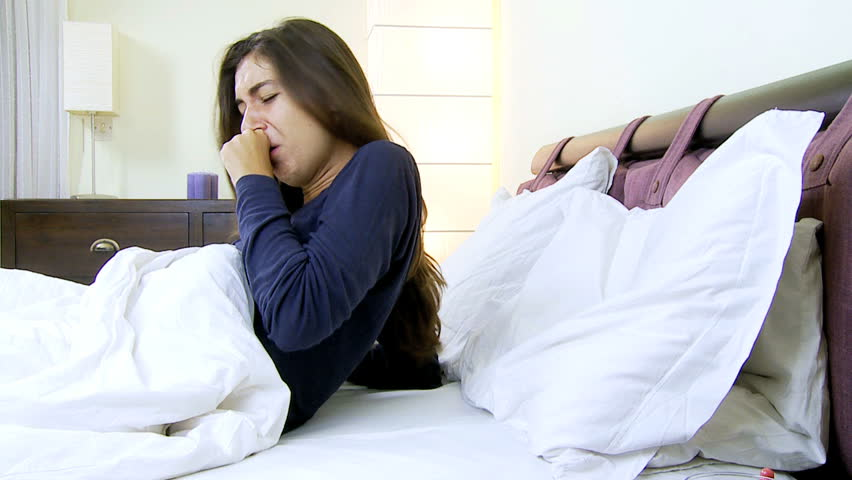 Woman very ill at home in bed feeling very sic - HD stock video clip