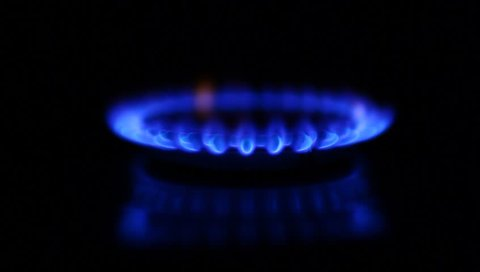 Natural gas inflammation in stove burner, soft focus, dark shot, turning on and off, switching gas on and off (HD, high definition 1080p)
