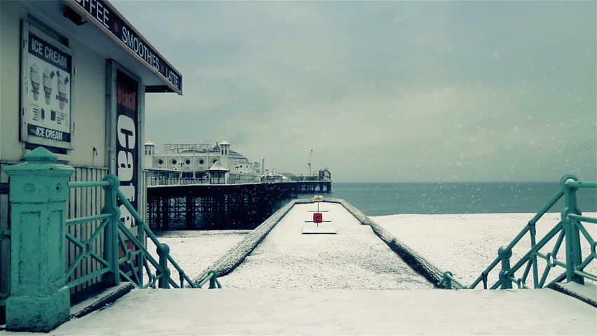 SNOW ON BRIGHTON BEACH AND PIER - HD stock video clip