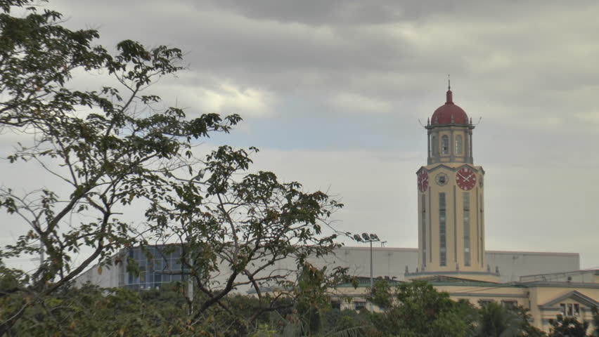 zoom-in clip of famous tower clock of Manila city hall, Philippines