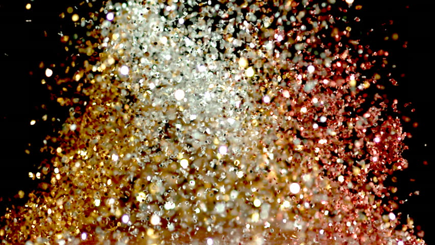 glitter exploding into a rainbow of colors slow motion