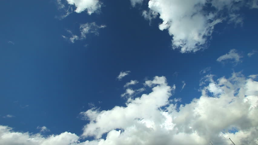 Fluffy clouds moving slowly on blue sky over highway #5456258