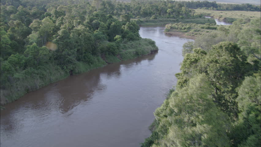 Birds eye aerial view of African land and water.