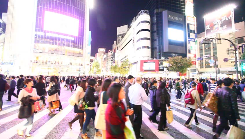 TOKYO - NOV 8 : Pedestrians at the famed crossing of Shibuya district November 8, 2013 in Tokyo, Japan. Shibuya is a fashion center and nightlife area. | Shutterstock HD Video #5467592