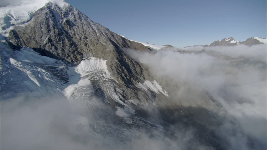 Above and in the clouds with blue sky and snowy mountains. Tibet. | Shutterstock HD Video #5468252