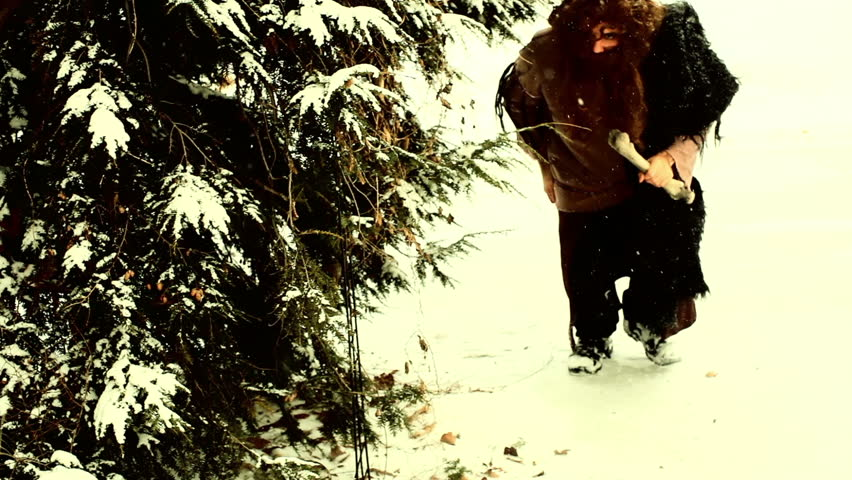 Caveman hunting in the snow