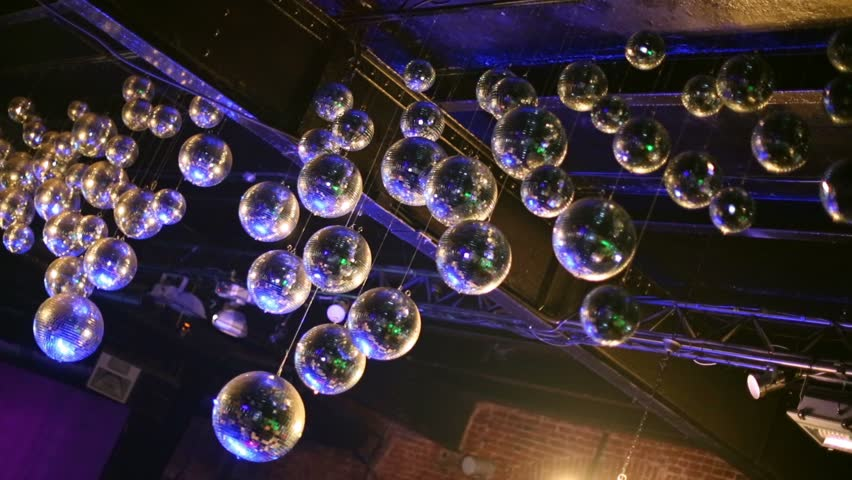 Party lights disco ball at a nightclub at blur stock footage video many different mirror balls on the ceiling in a nightclub hd stock footage clip aloadofball Image collections