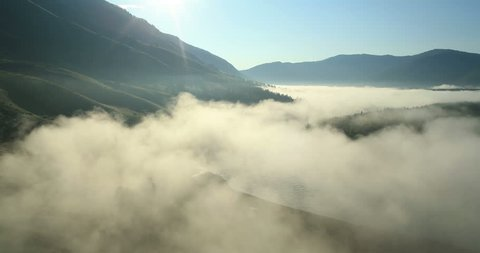 Flight over the Mountains. Altai. Siberia. Flying over the River. Forest Valley. Morning Fog