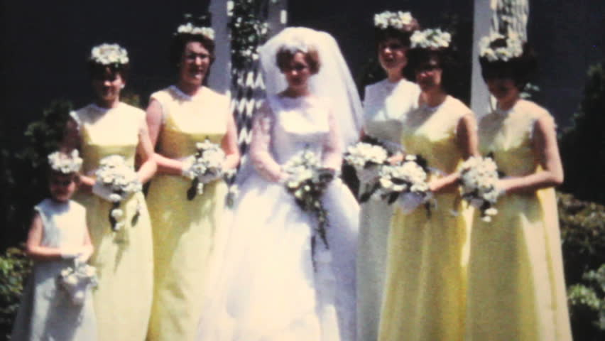 PITTSBURGH, PENNSYLVANIA, 1966: A beautiful bride and her bridesmaids pose for pictures after her wedding in the summer of 1966.