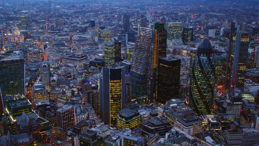 4K Aerial shot of Central London with a view of the City Financial District, Liverpool Street, Gherkin, at dusk
