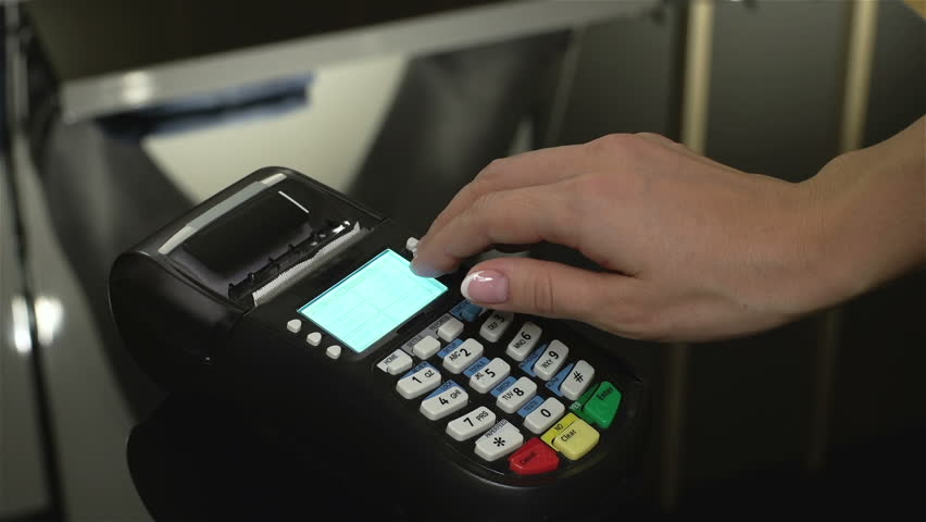 Close-up of a salesperson using a cash register