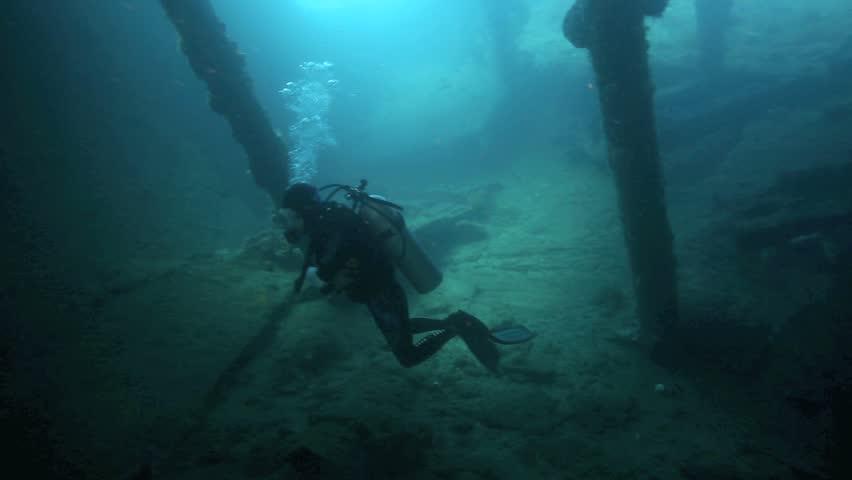 Scuba diver exploring inside the Liberty shipwreck in Tulamben, east Bali | Shutterstock HD Video #5586158