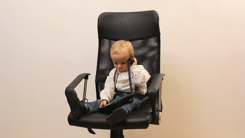 Kid At Phone On Office Chair Playing The Little Businessman Stock Footage  Video 5601218 | Shutterstock