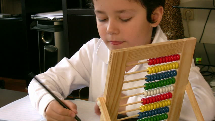 Boy Studying mathematics with abacus