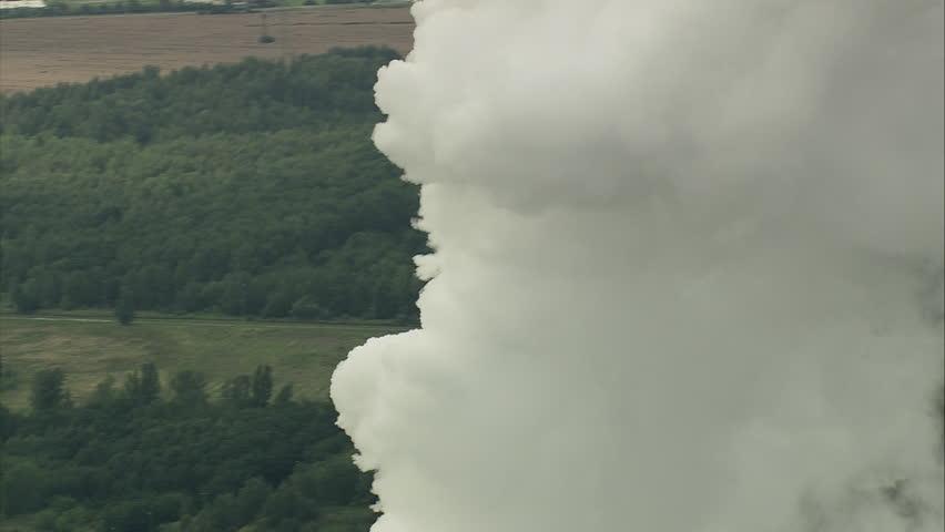 Power station chimneys and smoke - Shot circling smoke from power station chimneys