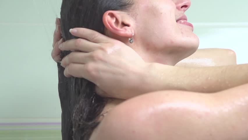 Shower. Young woman taking a shower and washing hair with shampoo. Conditioner hair. Beautiful girl enjoying a shower. Body care. Slow motion video footage 240fps. Bath. Douche. 1080p HD video footage