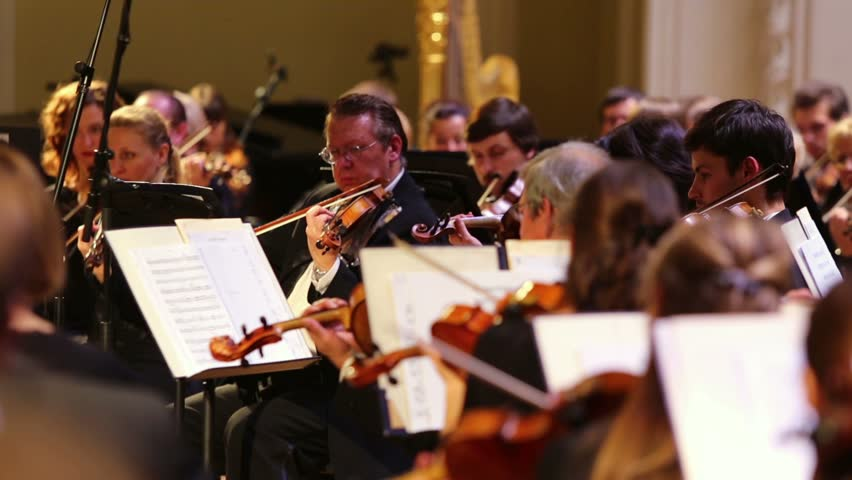 RUSSIA, MOSCOW - OCT 4, 2012: Violinists playing classical music with orchestra at Moscow Tchaikovsky Conservatory during Gala evening dedicated to 100 anniversary of All-Russian Museum Association