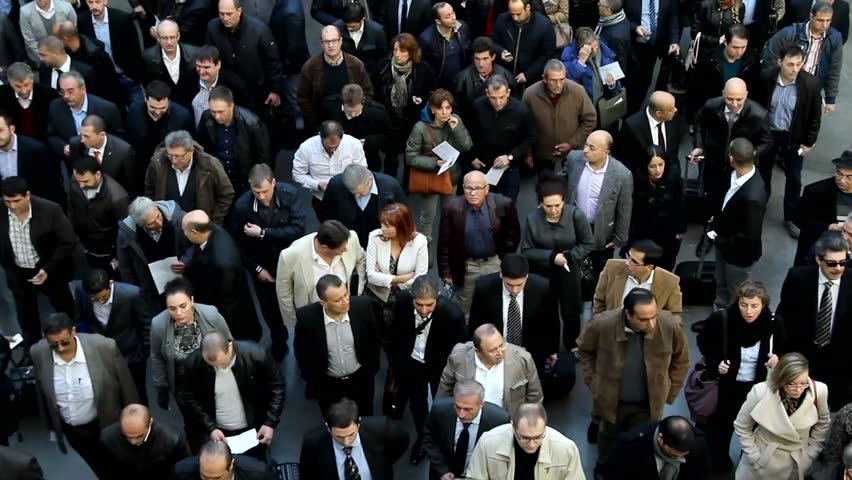 VALENCIA, SPAIN - FEBRUARY 12, 2014: A crowd of business people waiting to enter the 2014 Feria Habitat Valencia Trade Fair in Valencia.