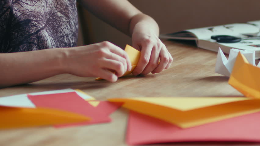 Hands Of Woman Folding Origami Crane With Yellow Paper Time Lapse