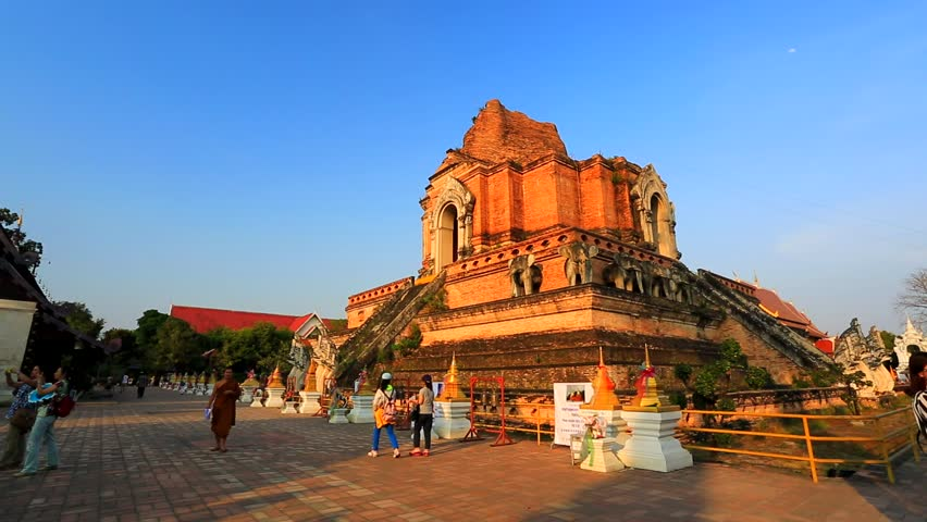 CHIANG MAI, THAILAND - CIRCA FEB 2014: Tourists visit Wat Chedi Luang temple. Wat Chedi Luang is a Buddhist temple in the historic centre of Chiang Mai, Thailand.