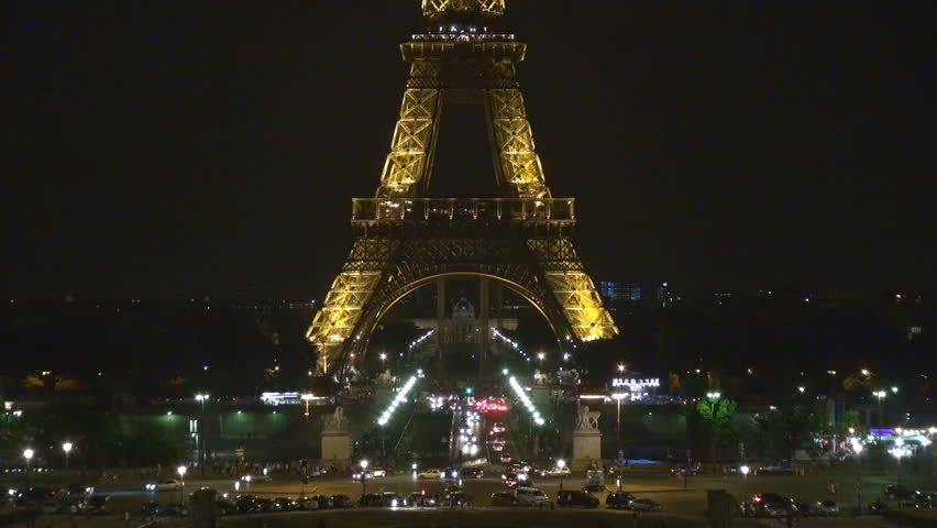 PARIS - JULY 25, 2013, Traffic car street and Eiffel Tour by night, beautiful illuminated landmark | Shutterstock HD Video #5645528