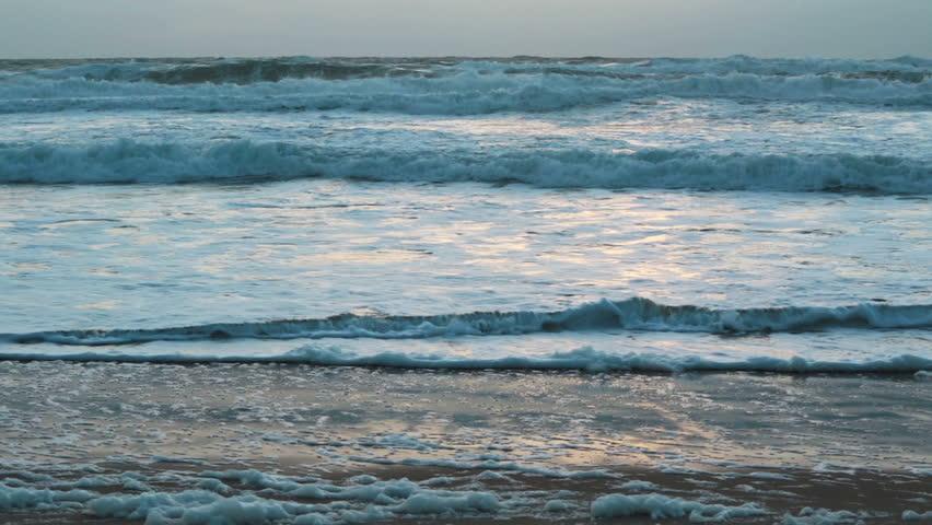 Sunset storm waves crashing during windy evening on Atlantic ocean