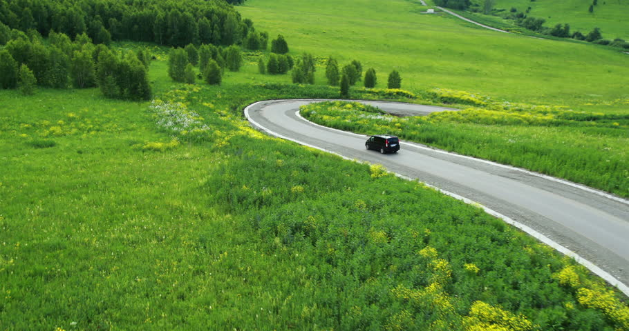 Aerial View. Car on a winding road in the hills. Altai Mountains, Siberia, Russia. Summer 2013 | Shutterstock HD Video #5656583