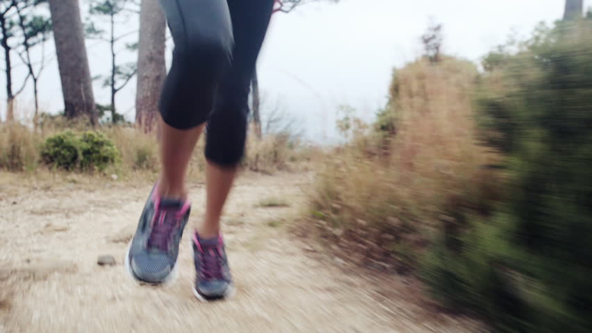 woman running trail close up shoes steadicam shot