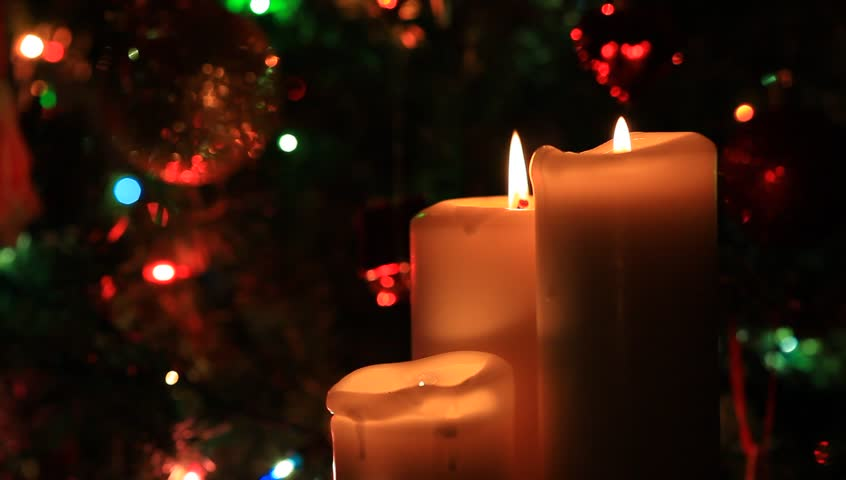christmas and new year decoration burning candles on blinking lights background stock footage video 5724098 shutterstock - Candle Christmas Lights