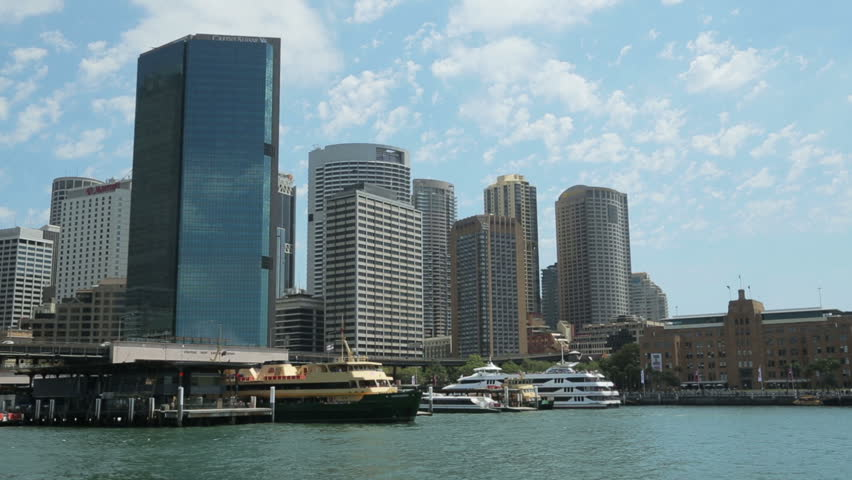 SYDNEY, AUSTRALIA - FEBRUARY 01, 2014: Manly Ferry boat leaves Circular Quay in front of the Sydney skyline