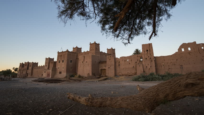 Wide Time-lapse of traditional Kasbah at sunrise in Morocco