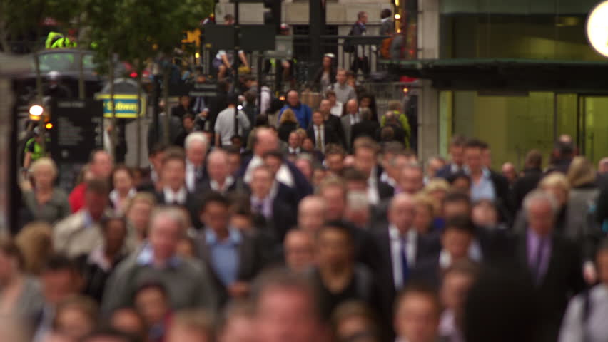 Business people on a busy street in London