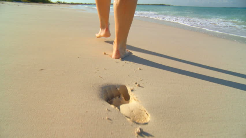 Young caucasian girl leaving footprints in the white sand of a tropical beach 60 FPS #578686