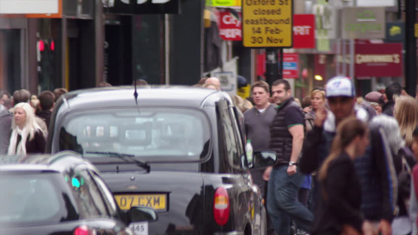 LONDON, UK - OCTOBER 8, 2011: People and traffic in slow motion.