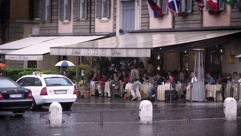 ROME, ITALY - MAY 7, 2012: Covered roman cafe filled with people eating