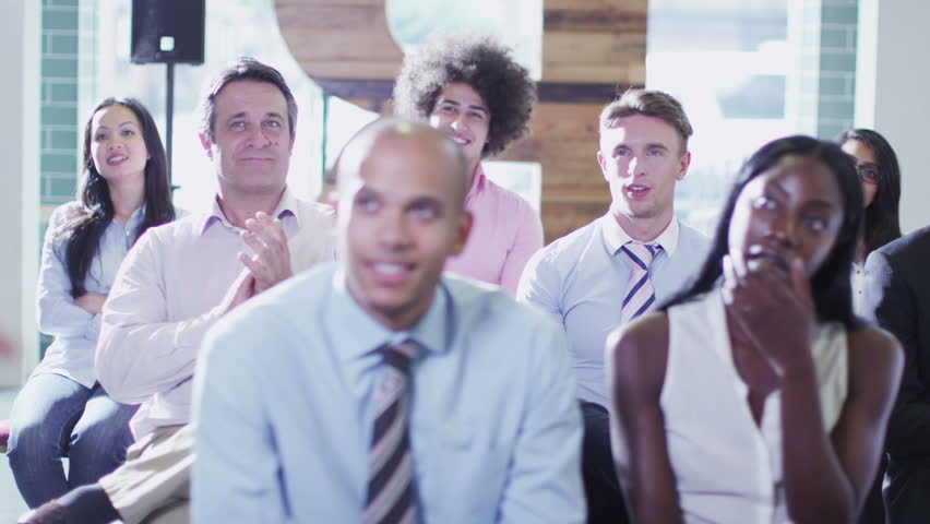 Cheerful diverse business group applaud the speaker at the end of a business presentation or training seminar.  | Shutterstock HD Video #5853329