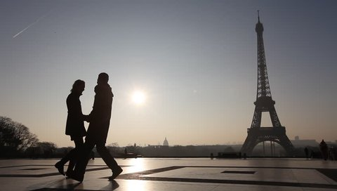 silhouettes of romantic loving couple near Eiffel Tower, Paris, France