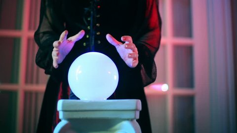 Fortune teller, or witch using a crystal ball