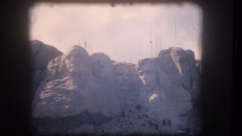 UNITED STATES - CIRCA 1950s: Old home movie film: Mount Rushmore Presidents Park
