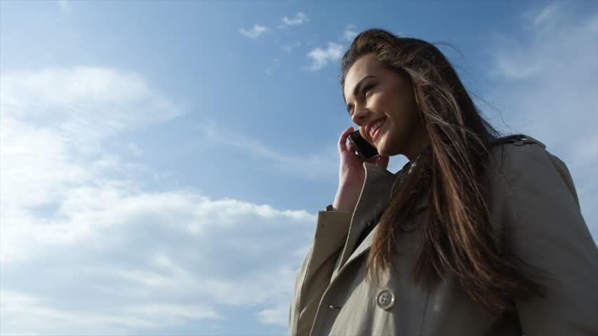 Young girl with phone against blue sky | Shutterstock HD Video #5960588
