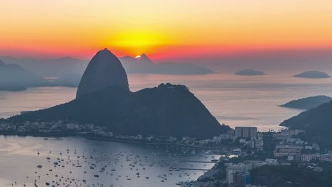 Rio De Janeiro zooming cityscape time lapse of sunrise over Sugar Loaf Mountain.