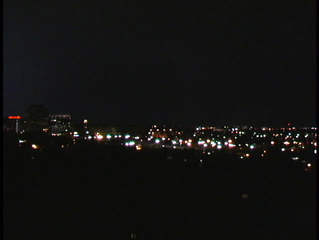 Nighttime lightning storm behind the lights of downtown Colorado Springs.