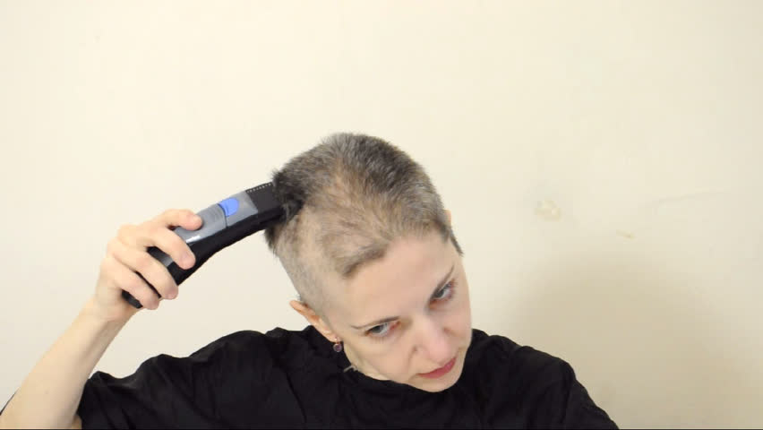 Female shaving her head bald