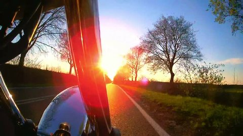 Motorcycle on the road , pov with flare