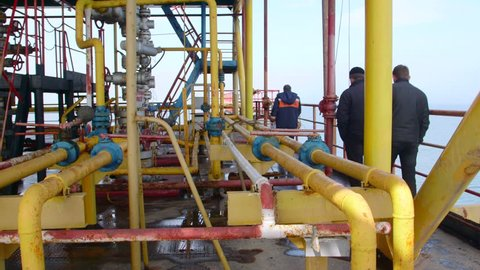 Sea of Azov, Crimea - March 28, 2014: Staff members at offshore gas production platform in the East-Kazantip field