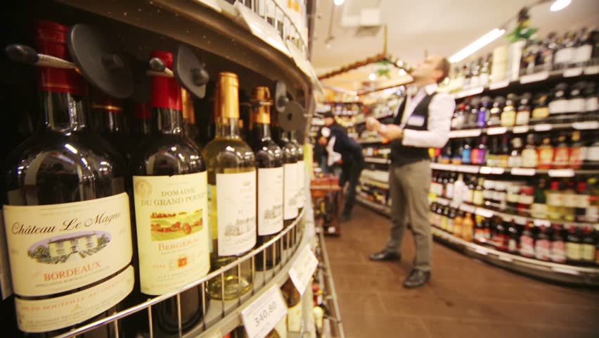 MOSCOW, RUSSIA - DEC 8, 2012: Wine on shelves in supermarket of home food Bahetle. Currently company Bahetle has 25 stores.