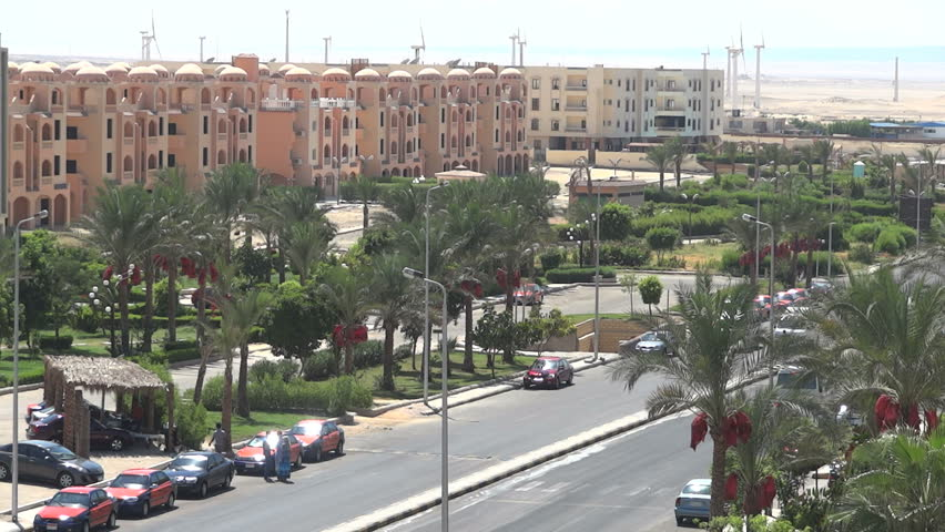 Street in the resort city of Egypt. passing cars and walking people Progressive scan. No audio.
